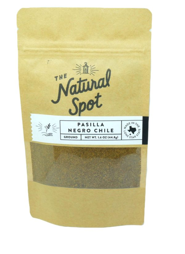 Ground Pasilla Negro Chile peppers In a small bag from the Natural Spot